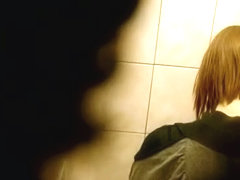 Skinny redhead with short hair, shows ass and takes a piss on a toilet