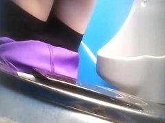 Purple pants woman pissing