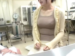 Busty Jap gets a dildo up her twat during medical exam