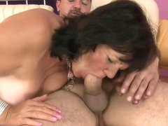 Busty brunette mature Helena invites a young man to fulfill her needs