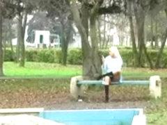 Spying Girl On Phone on Public Garden