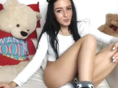 Stunning young babe puts her sexy long legs on display on t