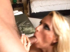 Blonde slut Holly Halston with nice big boobs giving a blow job