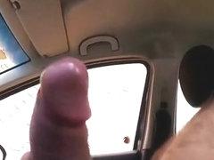 Dude masturbates his black cock inside car