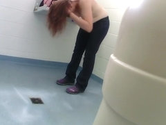 Desirable maid with pale tits changes clothes in a public toilet