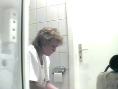 Mature is being filmed when urinating in the bathroom