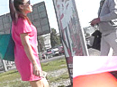Brunette girl in black panties caught on upskirt cam
