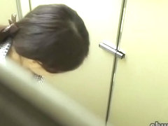 Japanese babe startled while letting her golden pee flow.