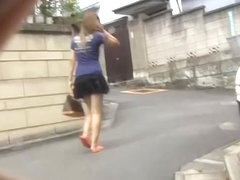 Japanese sharking master lifts up a cute girl's skirt