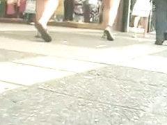 She is walking that street like a goddess in a black skirt