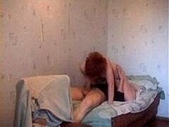 Short-haired redhead fucked
