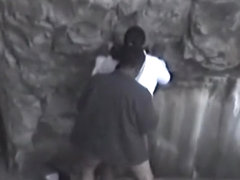 Guy fucks a black girl near rocks