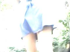 Hot brunette shows an up skirt view of her naked ass