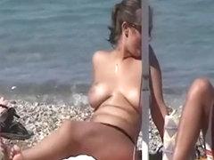 Topless women enjoying the sun