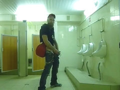 Guy stroke in public toilet
