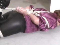 Girl with glasses hogtied and gagged