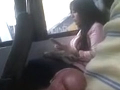 Guy plays with cock in bus