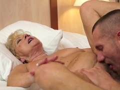 Blonde granny having sex with pretty stud