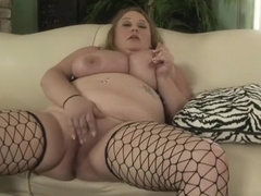 Curvy blonde in fishnets Sienna Hills reveals her body and masturbates