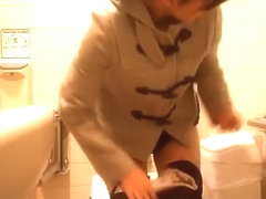 Asian woman caught in public toilet peeing