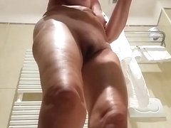 Mature wife spied in bathroom taking off her clothes