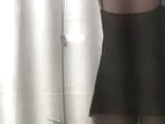 Blonde checks out booty while caught on shower spy cam video