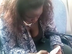 Ebony girl with big tits cleavage on the bus