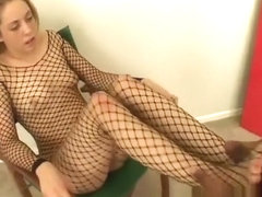 Sexy blonde in a fishnet bodysuit Roxxy Sweet delivers a nice footjob