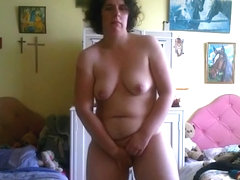 Nerdy chubby girl strips, rides a pillow and fingers her pussy standup.