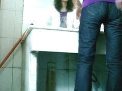 Tiny pee cam clip of an Asian girl crouching over the toilet